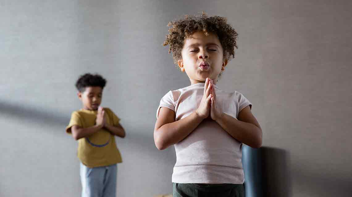 Girl and boy practicing yoga