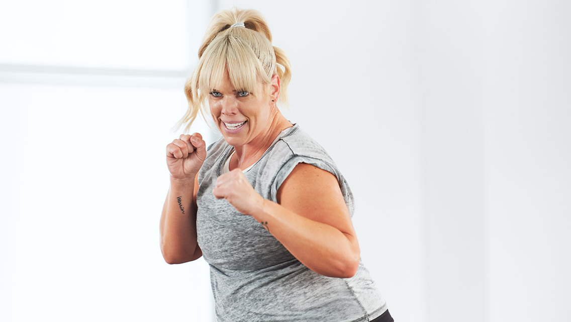 a women holds up her hands in a boxing stance