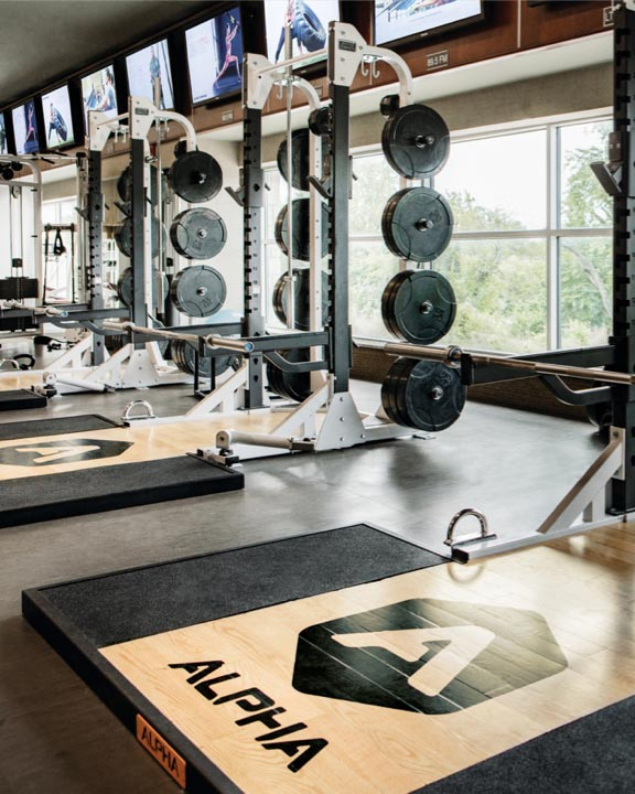 Olympic-style weight lifting equipment on the fitness floor at Life Time