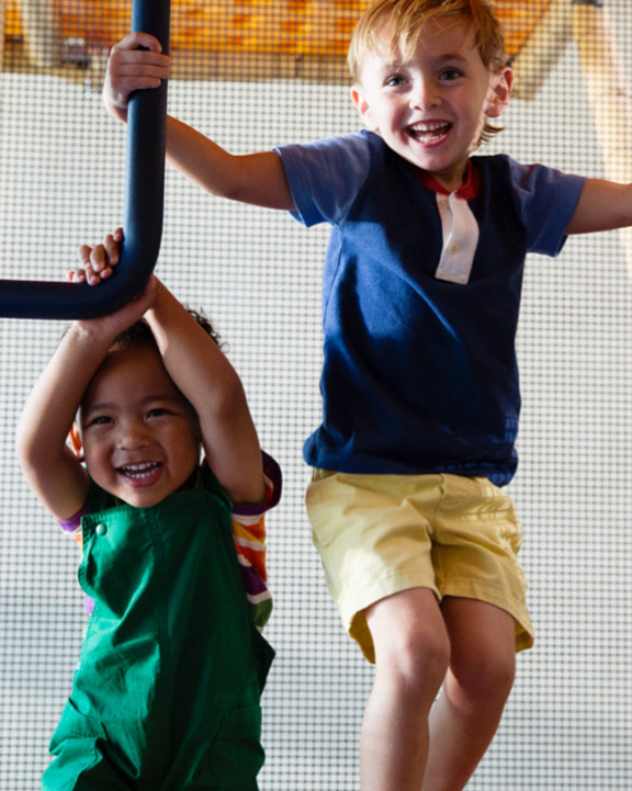 Kids playing on an indoor playground at Life Time