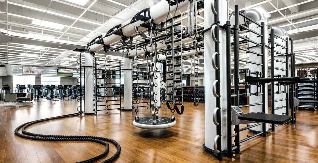 A multi-user functional fitness structure with suspension ladders, weight benches and battle ropes