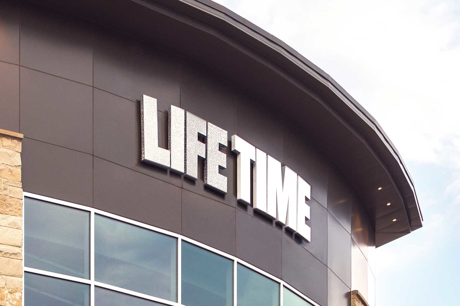 The Life Time logo at the top of a Life Time building