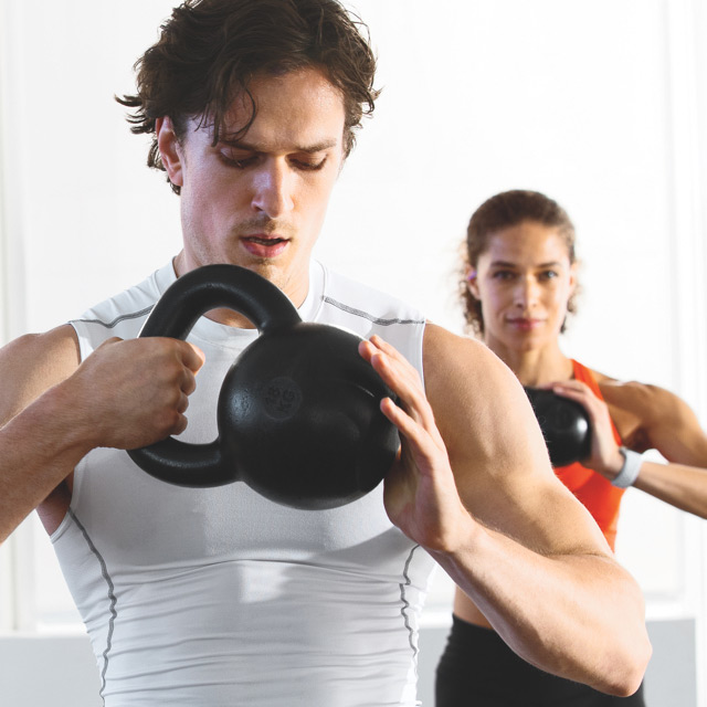 A man and a woman in a group fitness class