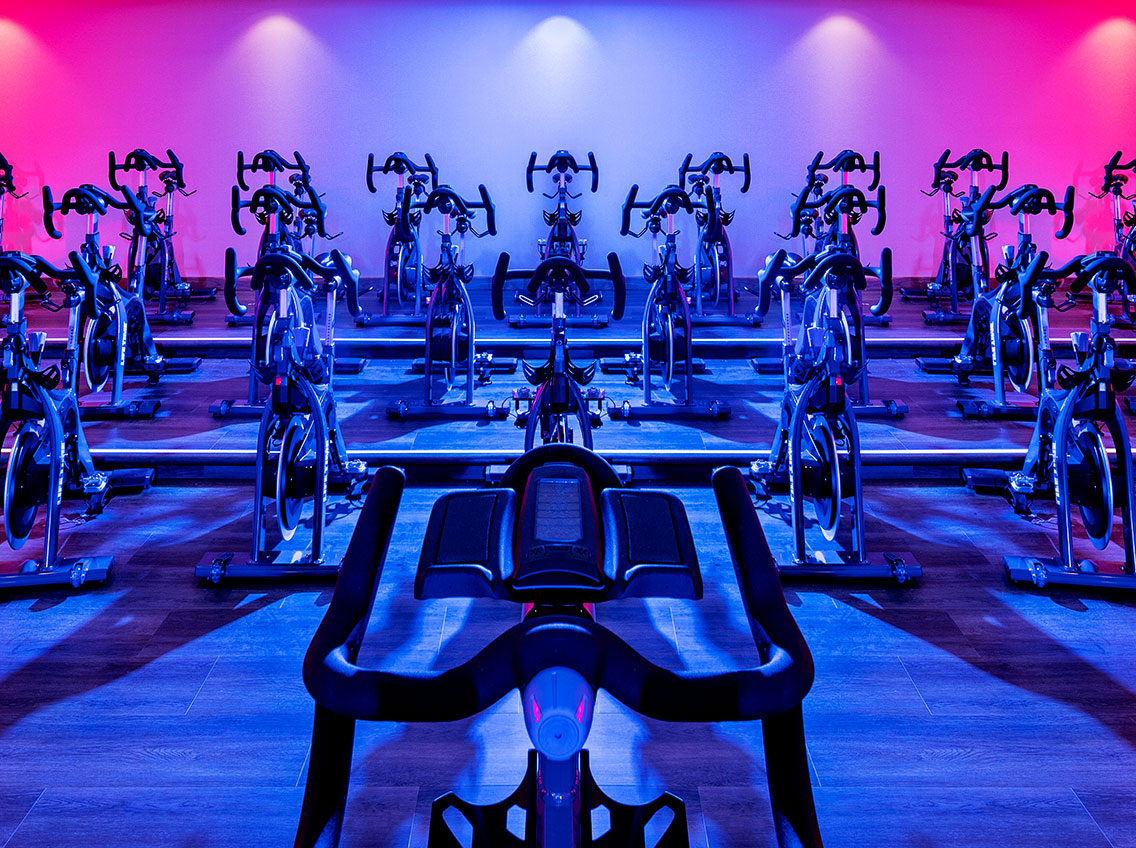 Indoor cycle studio at Life Time Battery Park