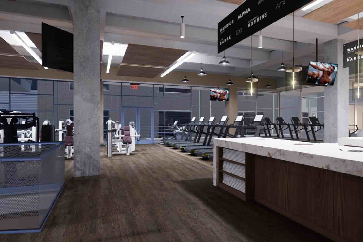 the training desk with treadmills on the fitness floor in the background