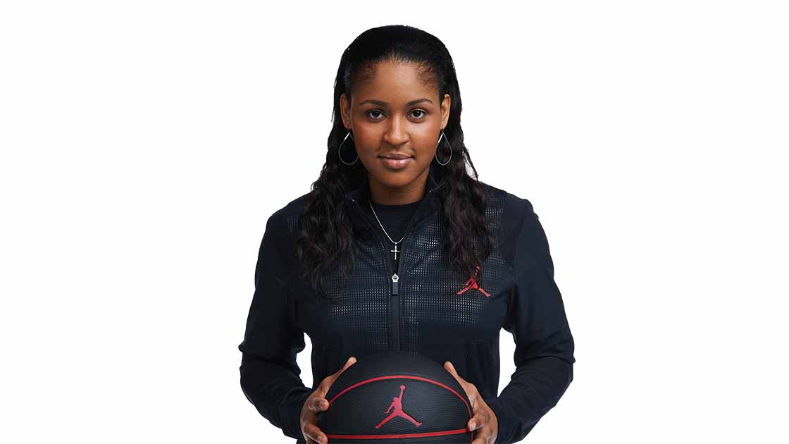 Image of Maya Moore holding a basketball
