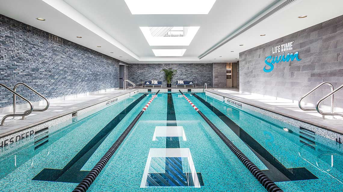 Image of the indoor lap swimming pool at Life Time Sky
