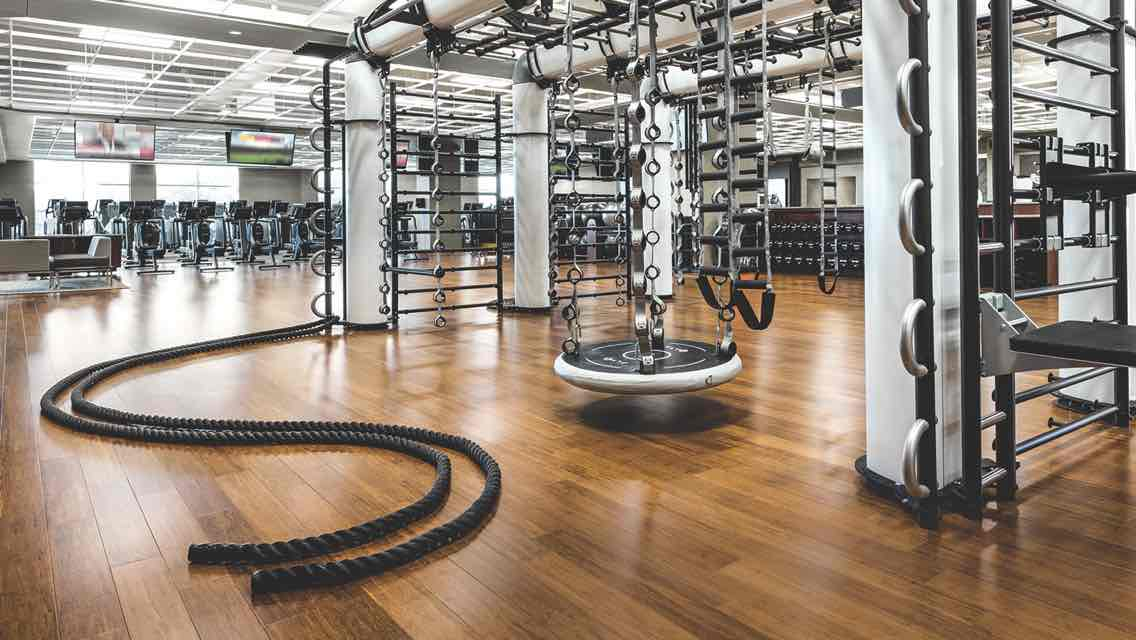 A spacious fitness floor featuring a large functional training structure