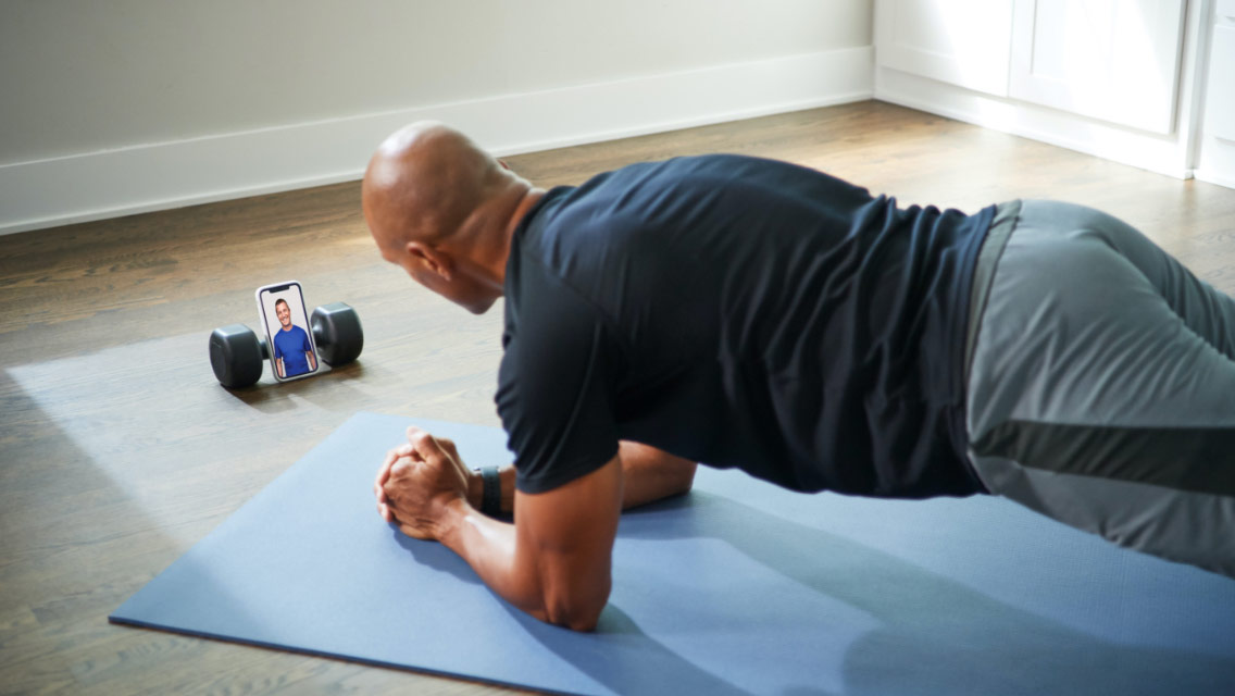 Man working out on a yoga mat at home