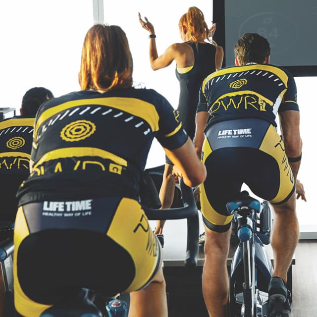 Group of people riding bike in power class
