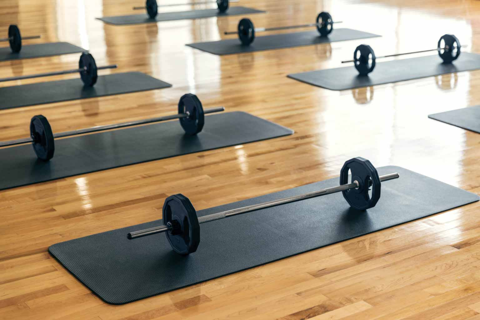 weights on mats in a studio