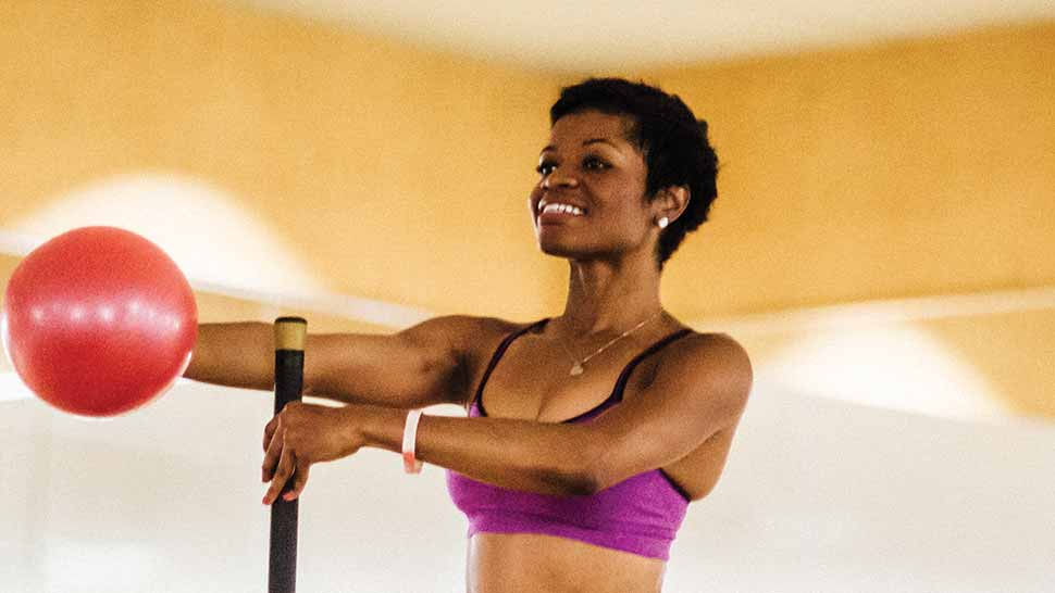 graceful woman teaching a barre class