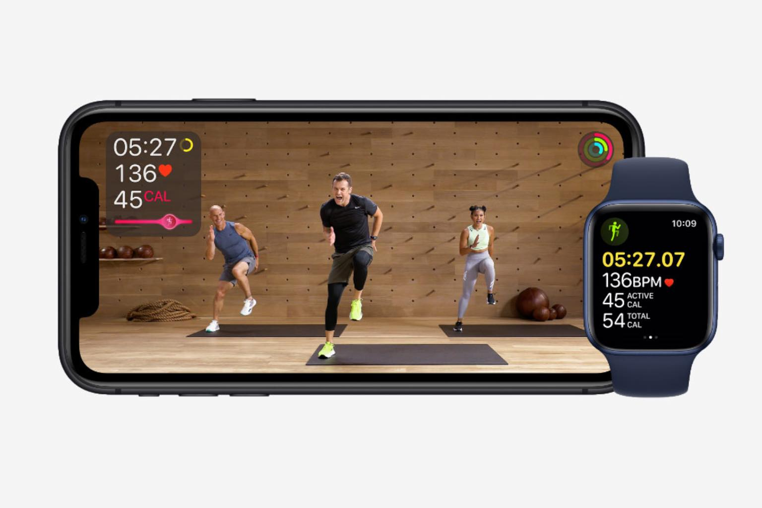 iPhone screen and Apple Watch showing AppleFitness+ video workout