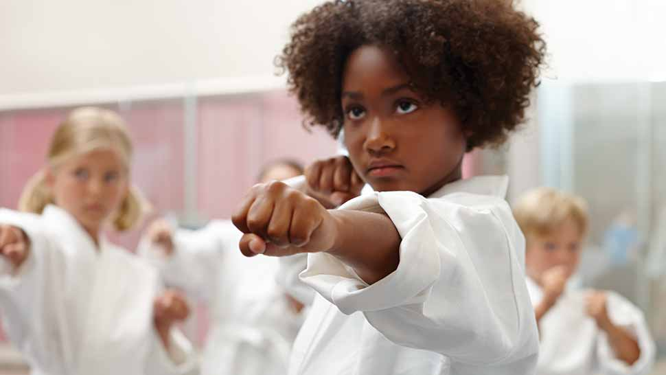 kids learning martial arts in class