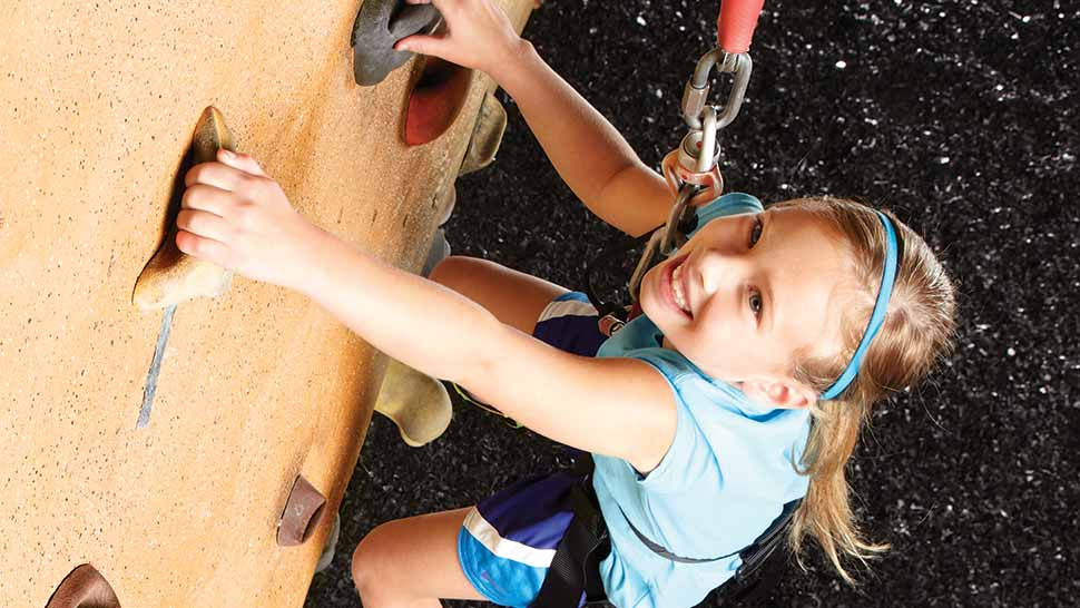 image of a girl rock climbing
