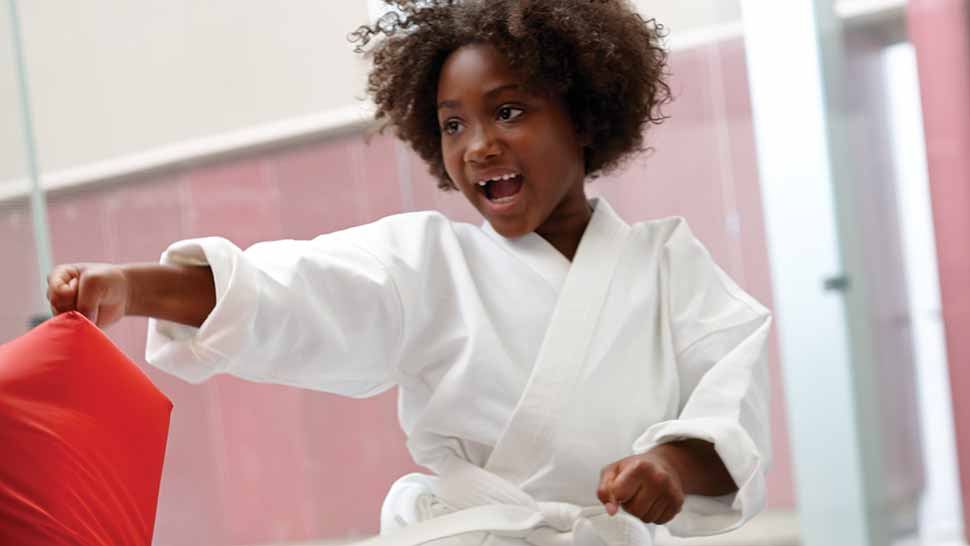 image of a girl practicing martial arts