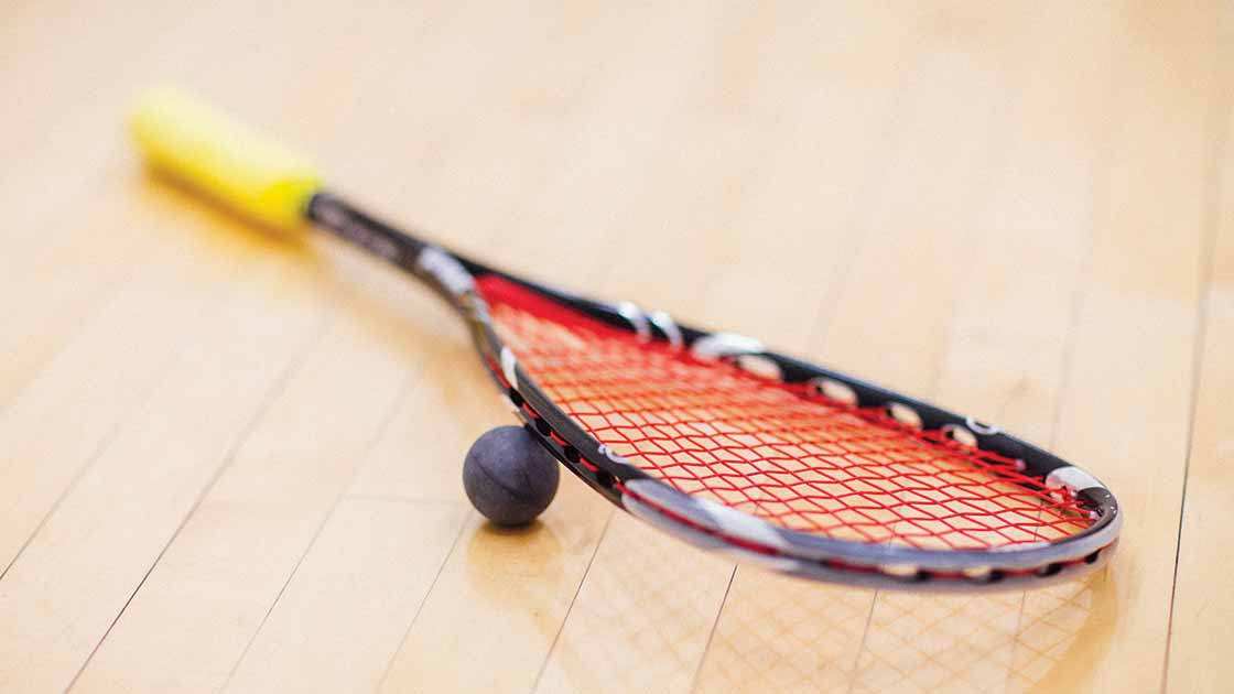 image of a squash raquet and squash ball