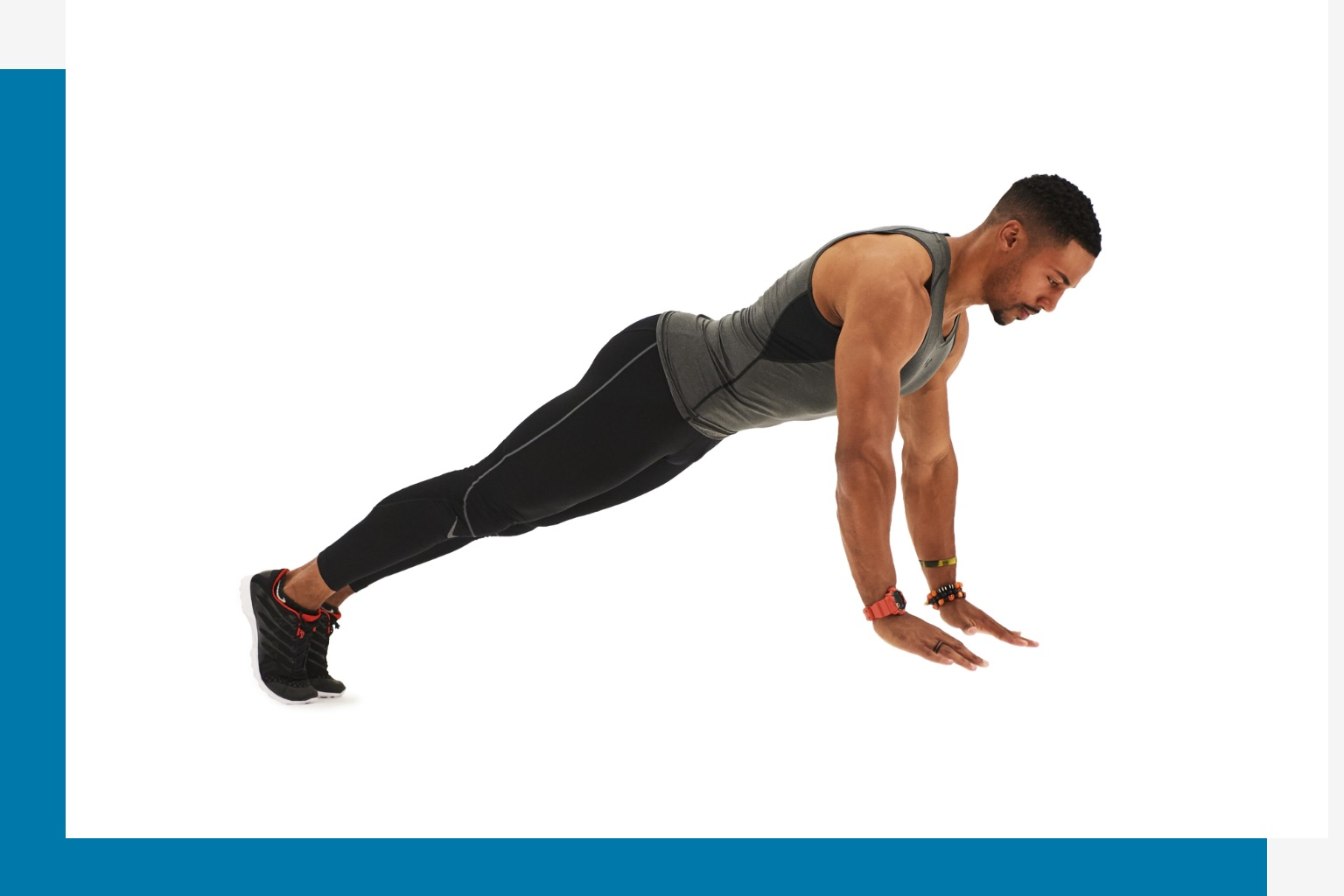 Man holding a straight arm plank.