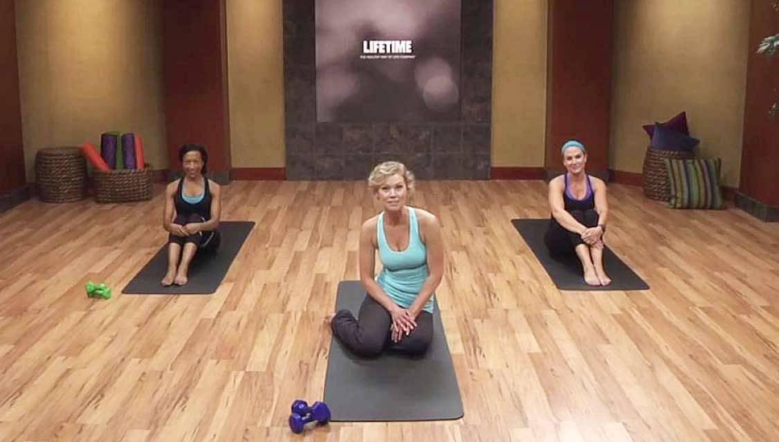Three woman on yoga mats