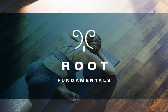A woman in a root yoga class