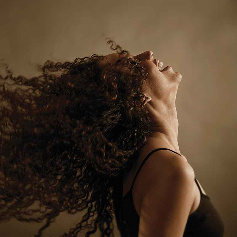 Image of woman tossing her hair and laughing
