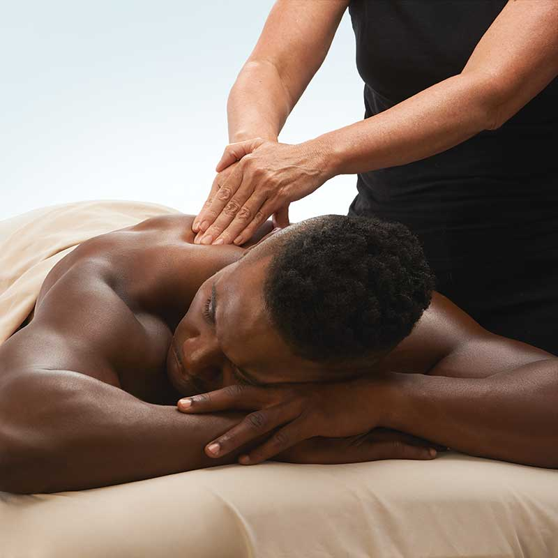 Man lying on a table getting a massage