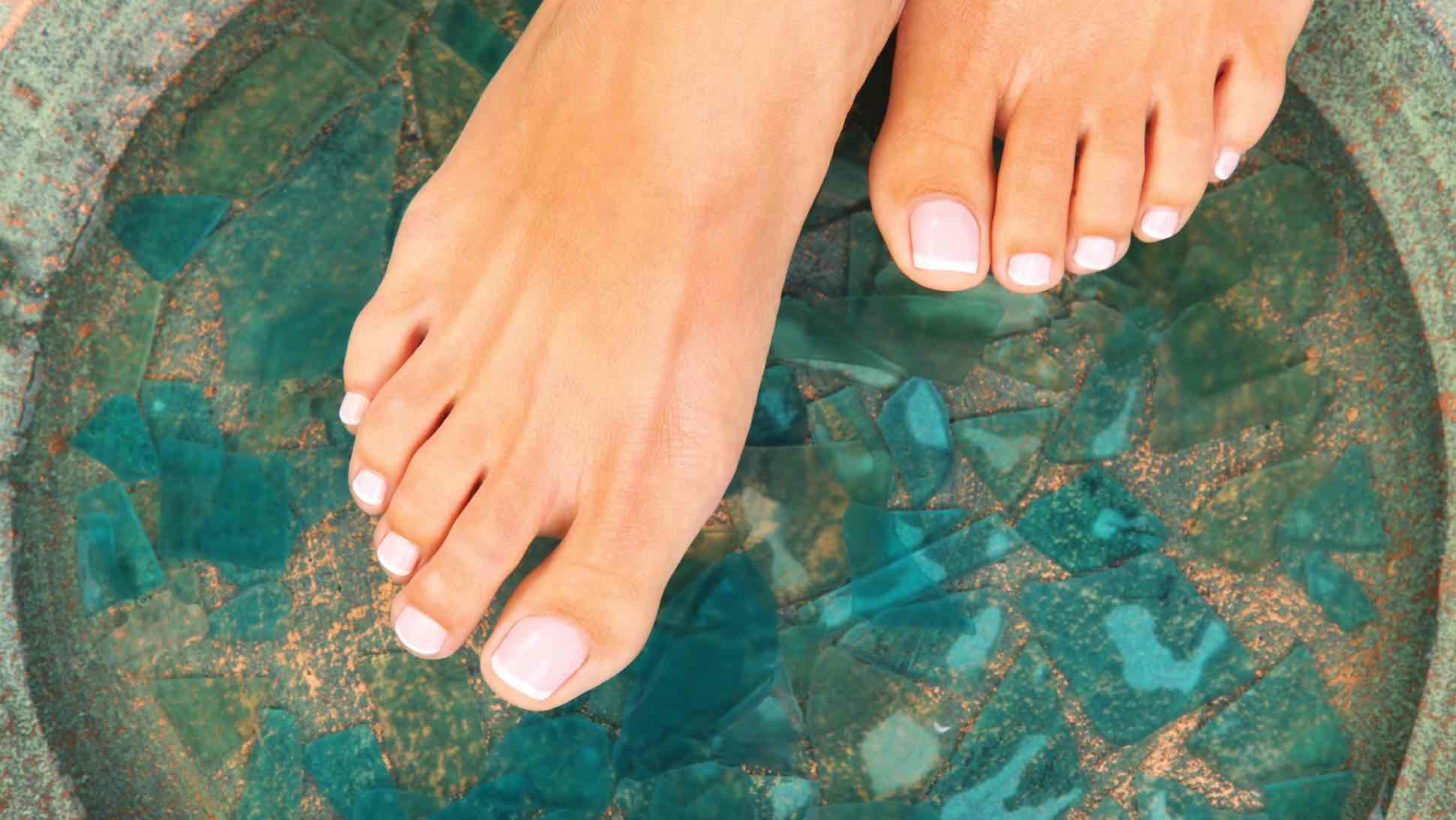 Image of toes preparing for a pedicure