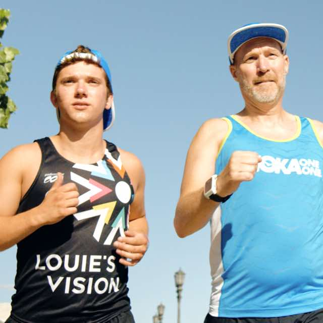 Louie McGee running with his triathlon partner