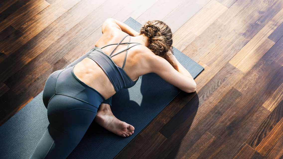 Woman stretching on a yoga mat