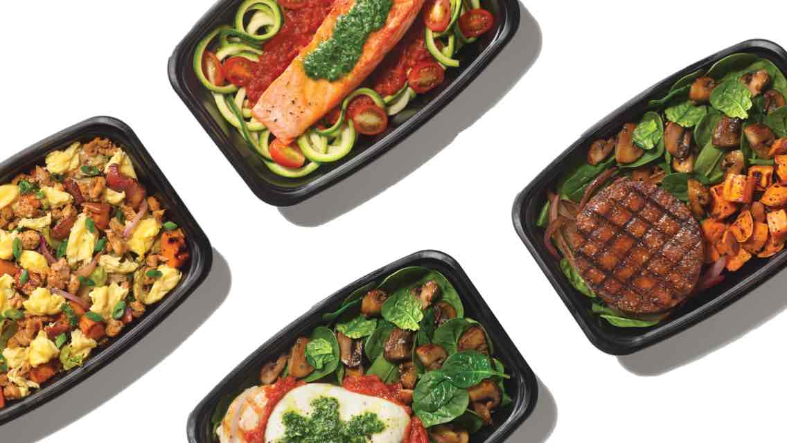 Aerial view of four grab-and-go healthy meals from the LifeCafe