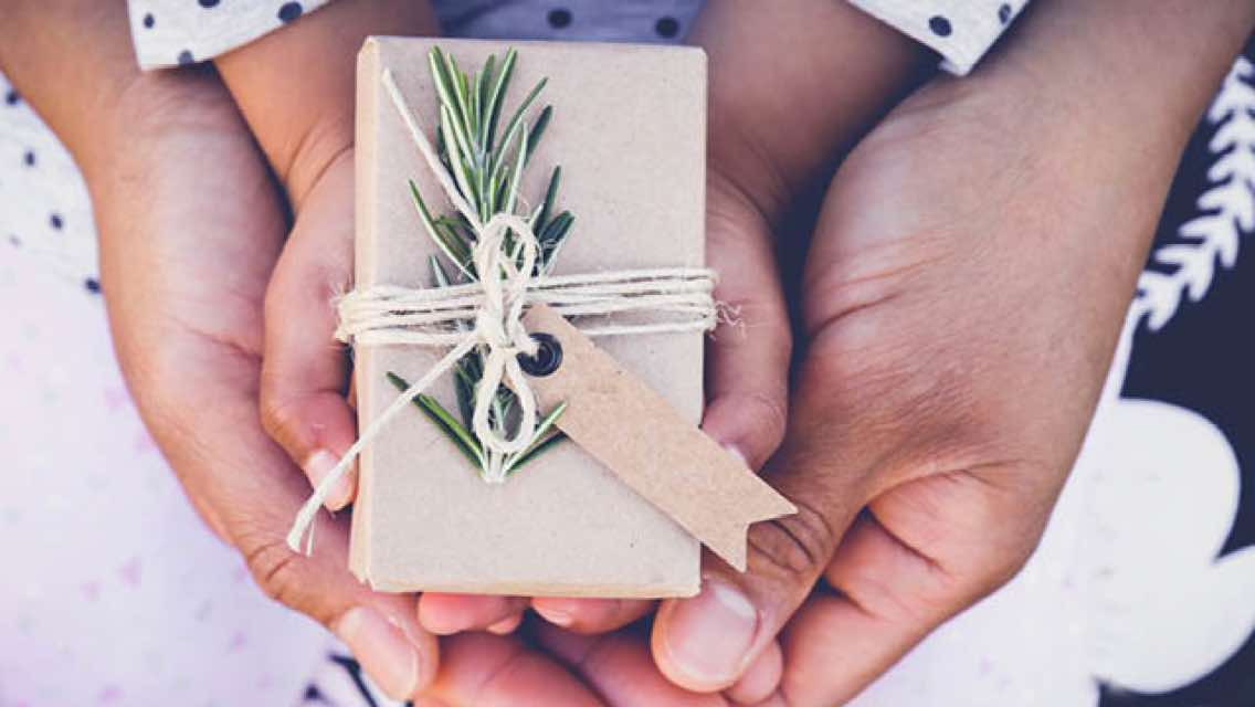 Small gift wrapped in brown paper and tied with a white string