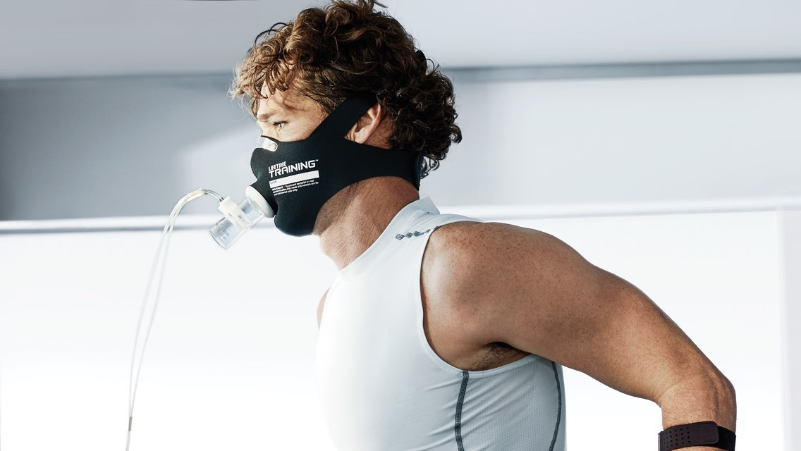A man wearing a black oxygen mask during a metabolic assessment with Life Time Training