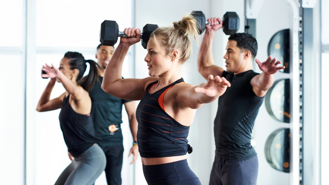 Four people working out in a small group training class at Life Time