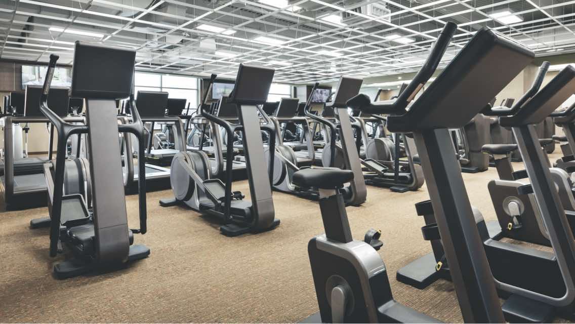 Fitness floor at Life Time with rows of elliptical machines