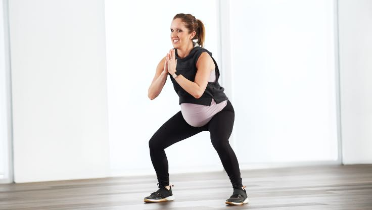 Woman doing at home family hit workout with Life Time Classes On Demand