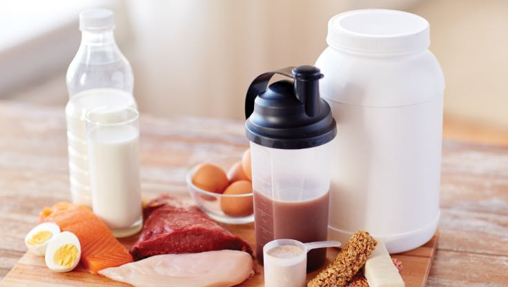 30 grams of protein displayed as a protein shake, milk, eggs, meat and nuts,