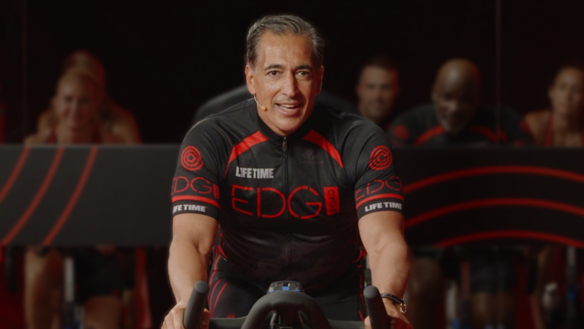 Life Time Founder leading a livestream cycle class