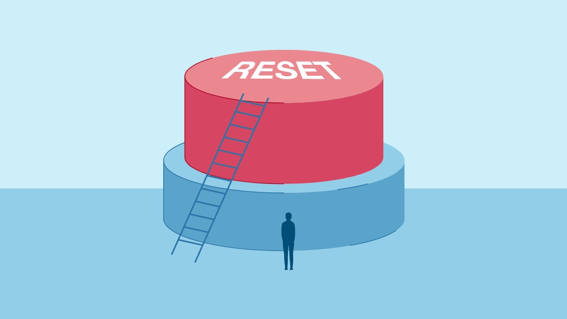 Illustrated image of a large button with reset written over it