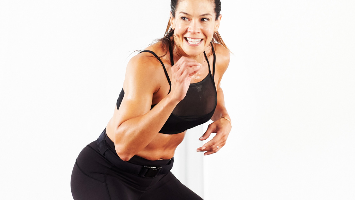 an energized woman performs an exercise move