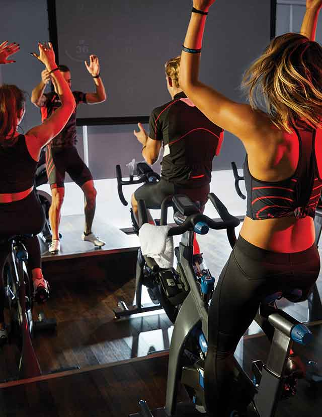 a pumped up group at one of our indoor cycling classes
