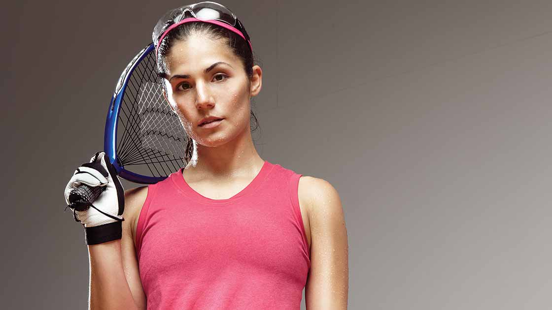 Image of a woman in a pink shirt and raquetball gear