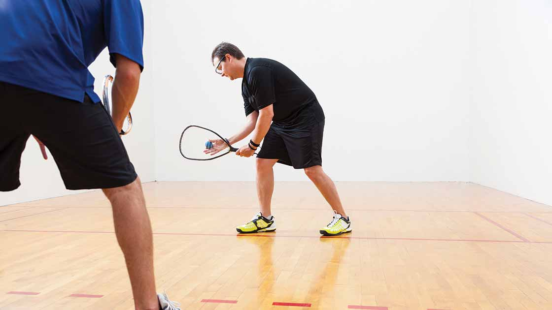 Image of two men playing racquetball