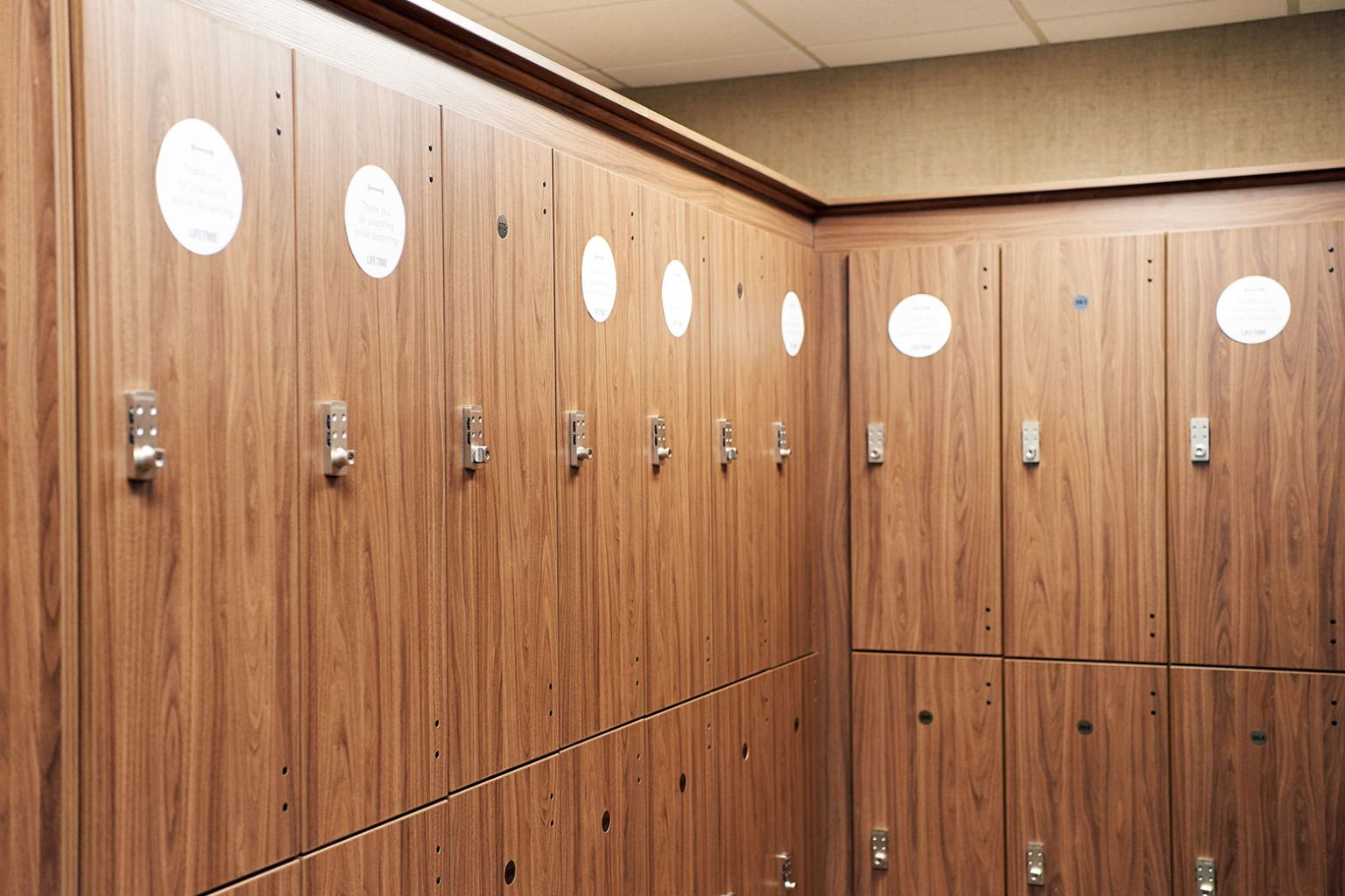 Lockers with social distance stickers on them.