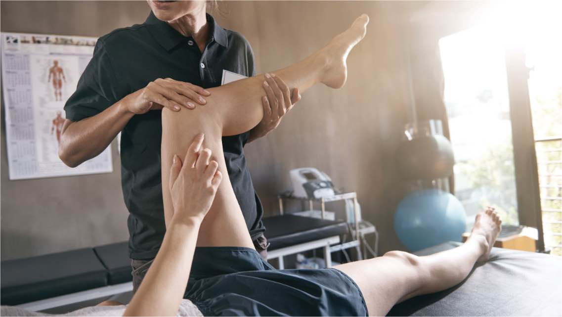 Physical Therapist helping a member stretch