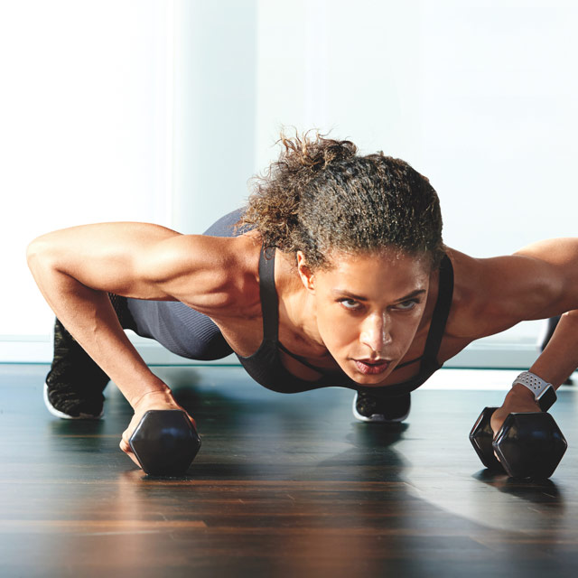 Woman holding a plank in the Xtreme class