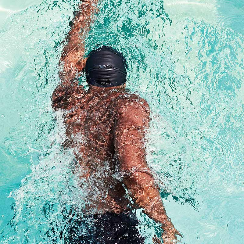 Image of an athletic man swimming