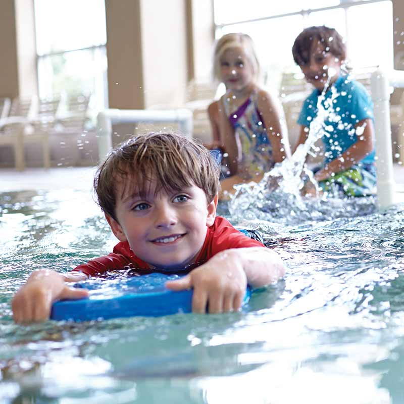 Image of three children at swimming lessons