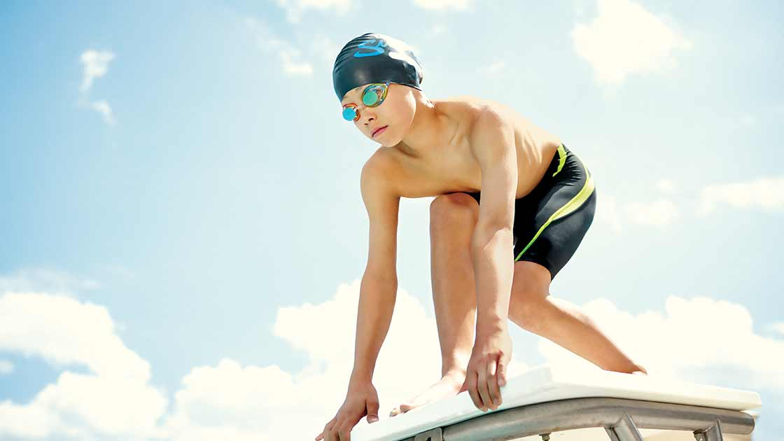 Image of a boy on a diving board