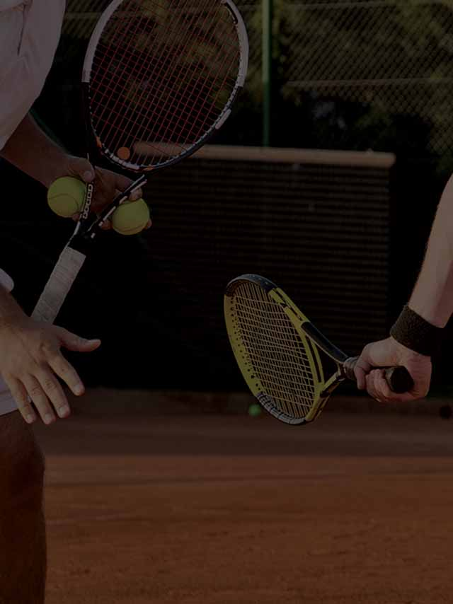 Darkened image of two men playing tennis