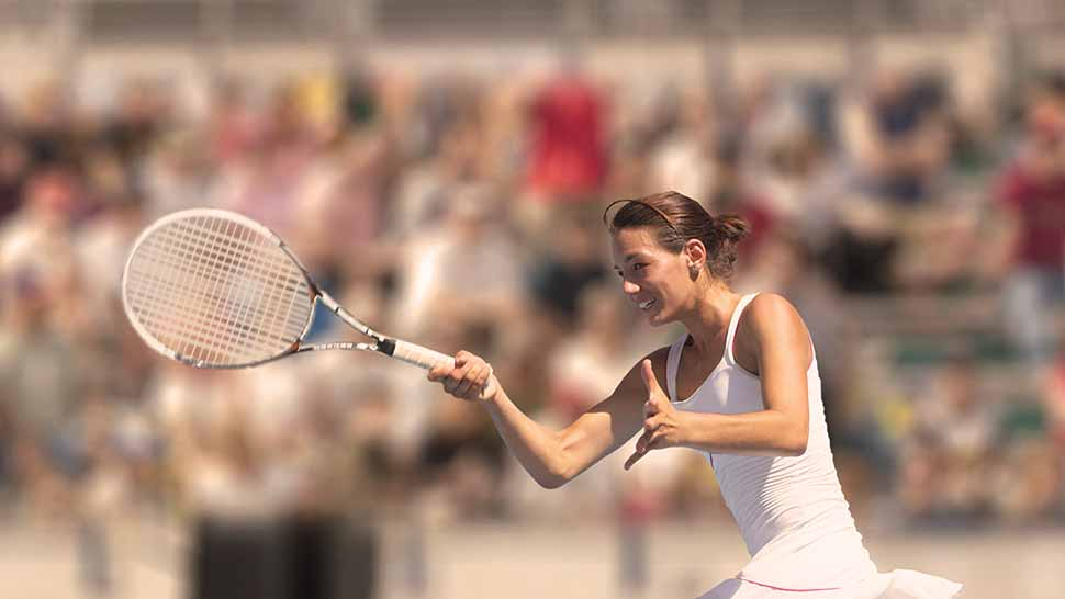 Image of a woman playing in a tennis match